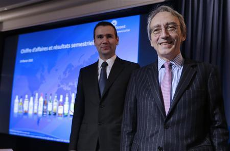 Pierre Pringuet (R), Chief Executive Officer of Pernod Ricard spirits giant, and Alexandre Ricard, Chief Operating Officer and Deputy Chief Executive Officer, attend a news conference to announce company results in Paris February 14, 2013. REUTERS/Jacky Naegelen