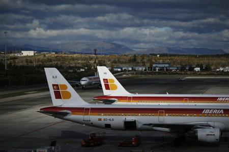 Iberia airplanes are parked on the tarmac at Madrid's Barajas airport November 29, 2012. REUTERS/Susana Vera