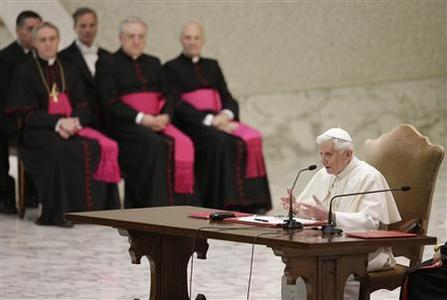 Pope Benedict XVI speaks as he leads a special audience with priests of the Diocese of Rome in Paul VI's hall at the Vatican February 14, 2013. REUTERS/ Max Rossi
