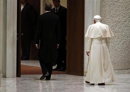 Pope Benedict XVI leaves at the end of his Wednesday general audience in Paul VI hall at the Vatican February 13, 2013. REUTERS/Stefano Rellandini