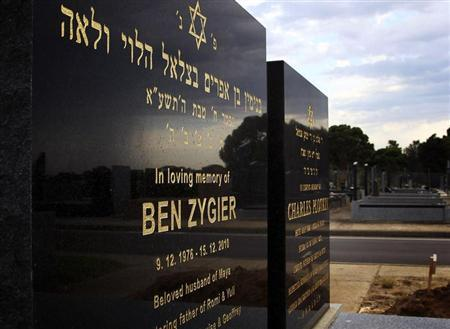 The grave of Ben Zygier (L), the Australian whom local media have identified as the man who died in an Israeli prison in 2010 and who may have been recruited by Israeli intelligence agency Mossad, is pictured at a Jewish cemetery in Melbourne February 14, 2013. Israel broke its official silence on Wednesday over the reported suicide in jail of an Australian immigrant recruited to its spy service Mossad, giving limited details on a closely guarded case. After appeals by local media chafing at Israeli censorship of a story broken by the Australian Broadcasting Corporation (ABC), a district court near Tel Aviv allowed publication of six paragraphs of sanctioned text - a de-facto preliminary account by the state. The text said an Israeli with an unspecified dual nationality had been secretly imprisoned ''out of security considerations'', only to be found dead in his cell two years ago in what was eventually ruled a suicide. REUTERS/Brandon Malone
