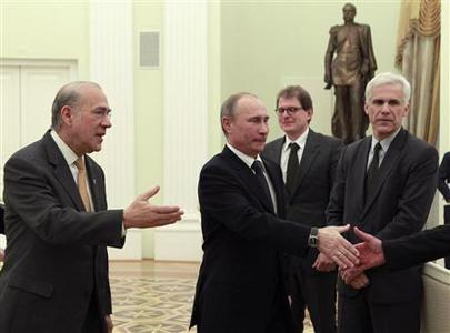 Organisation for Economic Co-operation and Development (OECD) Secretary-General Angel Gurria (L) presents members of the delegation to Russia's President Vladimir Putin during a meeting at the Kremlin in Moscow, February 14, 2013. REUTERS/Maxim Shemetov