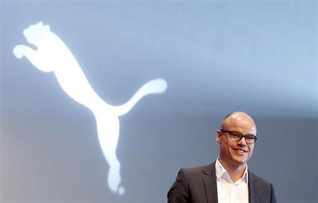 Franz Koch, head of strategy and development of German sports goods firm Puma arrives for the company's annual shareholders meeting in Herzogenaurach April 14, 2011. REUTERS/Michaela Rehle