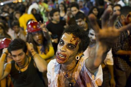 People dressed as zombies attend a Zombie Walk in Caracas November 3, 2012. REUTERS/Carlos Garcia Rawlins/Files