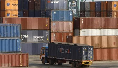A truck ferries a shipping container at a port in Chennai February 13, 2013. REUTERS/Babu/Files