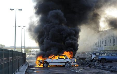 Anti-government protesters set a car on fire to create a road block to mark the second anniversary of the February 14 uprising, in Budaiya, west of Manama, February 14, 2013. PREUTERS/Hamad I Mohammed