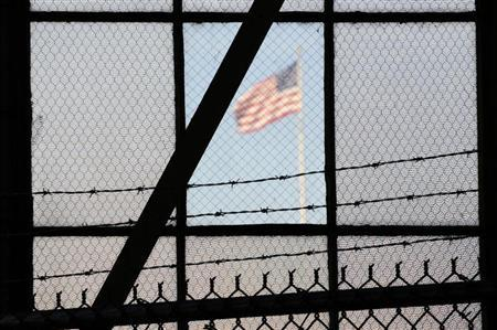The flag over a war crimes courtroom in Camp Justice at US Naval Base Guantanamo Bay in Cuba in this photo reviewed by the U.S. Department of Defense on October 17, 2012, day three of pre-trial hearings for the five Guantanamo prisoners accused of orchestrating the 9/11. REUTERS/Michelle Shephard/Pool