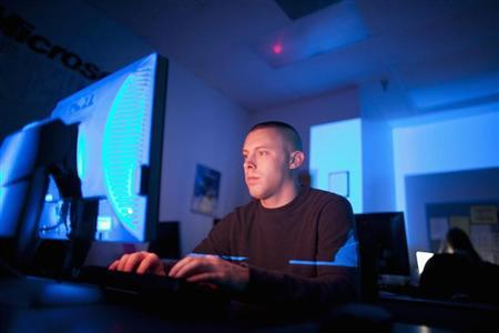 U.S. Marine Sergeant Michael Kidd works on a computer at ECPI University in Virginia Beach, Virginia, February 7, 2012. REUTERS/Samantha Sais