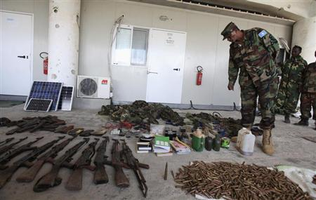 A member of the Somali National Army (SNA) inspects ammunitions and explosives recovered from Islamist al Shabaab militants in Somalia's capital Mogadishu, October 24, 2012. REUTERS/Feisal Omar