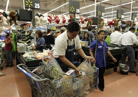 File photo of a worker bagging groceries at a Wal-Mart store in Mexico City November 17, 2011. REUTERS/Henry Romero