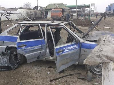 A police car is seen damaged by an explosion near a security checkpoint in the city of Khasavyurt, in the province of Dagestan, February 14, 2013. A suicide bomber killed three policemen and injured another six at a police security checkpoint early on Thursday, Russian investigators said, in the volatile North Caucasus region, where the Kremlin is fighting to staunch an Islamist insurgency. REUTERS/Abdula Magomedov/NewsTeam/Handout