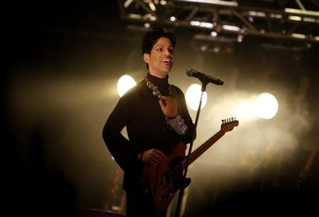 U.S. musician Prince performs on the main stage during Budapest's Sziget music festival on an island in the Danube River in this August 9, 2011 file photo. REUTERS/Bernadett Szabo/Files