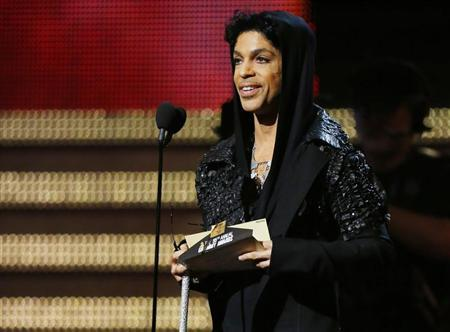 Singer Prince speaks on stage at the 55th annual Grammy Awards in Los Angeles, California, February 10, 2013. REUTERS/Mike Blake