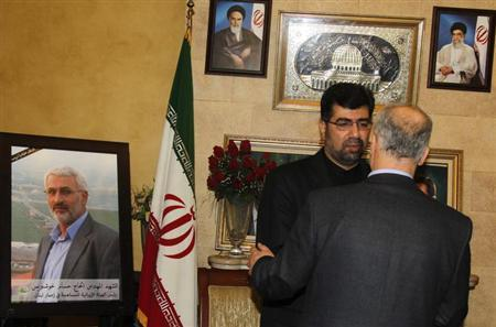 Iran's ambassador to Lebanon Ghazanfar Roknabadi (L) accepts condolences for the death of Hessam Khoshnevis, Iranian Revolutionary Guard commander in charge of Tehran's reconstruction assistance in Lebanon, at the Iranian Embassy in Beirut February 14, 2013. REUTERS/Sharif Karim