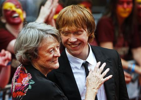Actors Maggie Smith and Rupert Grint share a light moment on the red carpet as they arrive for the world premiere of ''Harry Potter and the Half Blood Prince'' at Leicester Square in London July 7, 2009. REUTERS/Luke MacGregor