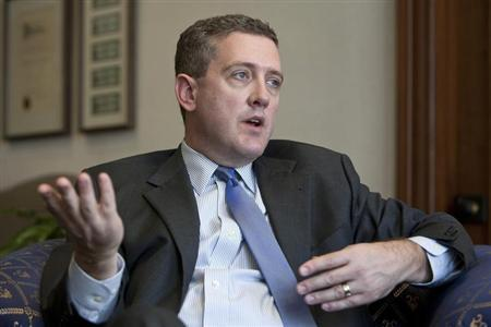 President and CEO of the Federal Reserve Bank of St. Louis James Bullard gestures during an interview at the Federal Reserve Bank of St. Louis June 8, 2011. REUTERS/Peter Newcomb