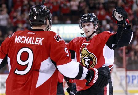 Ottawa Senators' Erik Karlsson (R) celebrates his goal with teammate Milan Michalek during the second period of their NHL hockey game against the Buffalo Sabres in Ottawa February 12, 2013. REUTERS/Blair Gable