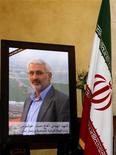 A picture of Hessam Khoshnevis is placed at the condolences hall at the Iranian Embassy at Beirut February 14, 2013. Khoshnevis, an Iranian Revolutionary Guard commander, has been killed inside Syria by rebels battling Iran's close ally President Bashar al-Assad, Iranian officials and a rebel leader said on Thursday. Syrian rebels have repeatedly accused Tehran of sending fighters to help Assad crush the 22-month-old uprising, a charge Iran has denied. REUTERS/Sharif Karim