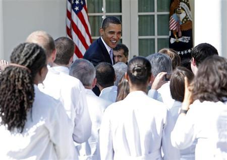 U.S. President Barack Obama greets doctors from across the country after making remarks on the need for health insurance reform in the Rose Garden at the White House in Washington, October 5, 2009. REUTERS/Jim Young