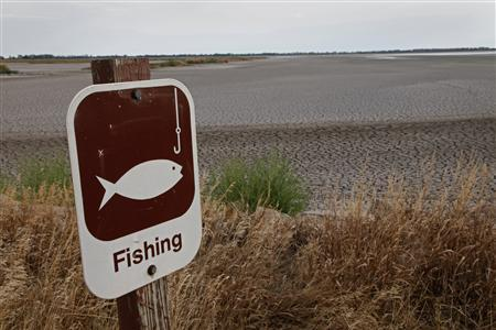 A fishing sign in at one of the dry pools at the Quivira National Wildlife Refuge in Hudson, Kansas August 7, 2012. REUTERS/Jeff Tuttle