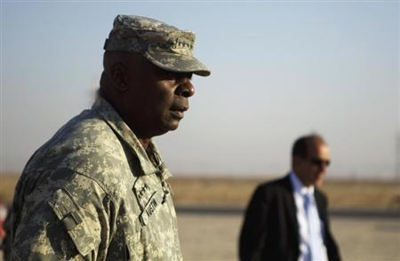U.S. Army General Lloyd Austin greets the last group of soldiers from the 3rd Brigade Combat Team, 1st Cavalry Division to cross the Kuwaiti border as part of the last U.S. military convoy to leave Iraq December 18, 2011. REUTERS/Lucas Jackson