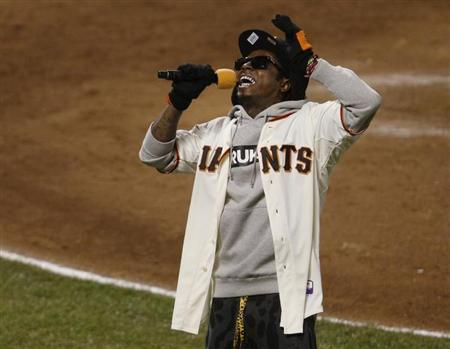 Rapper Lil Wayne sings ''Take Me Out To The Ball Game'' during the seventh inning stretch in Game 6 of the MLB NLCS playoff baseball series between the St. Louis Cardinals and the San Francisco Giants in San Francisco, October 21, 2012. REUTERS/Stephen Lam