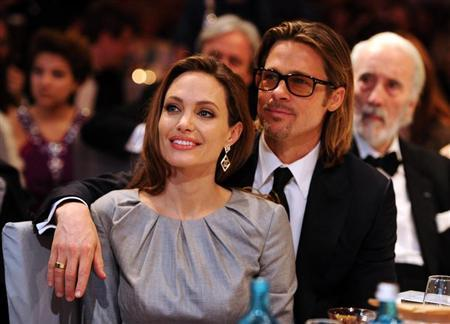 Angelina Jolie and Brad Pitt attend the ''Cinema for Peace 2012'' charity gala during the 62nd Berlinale film festival in Berlin February 13, 2012. REUTERS/Andreas Rentz/Pool