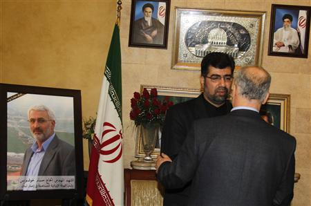 Iran's ambassador to Lebanon Ghazanfar Roknabadi (L) accepts condolences for the death of Hessam Khoshnevis, Iranian Revolutionary Guard commander in charge of Tehran's reconstruction assistance in Lebanon, at the Iranian Embassy in Beirut February 14, 2013. Khoshnevis, an Iranian Revolutionary Guard commander, has been killed inside Syria by rebels battling Iran's close ally President Bashar al-Assad, Iranian officials and a rebel leader said on Thursday. Syrian rebels have repeatedly accused Tehran of sending fighters to help Assad crush the 22-month-old uprising, a charge Iran has denied. REUTERS/Sharif Karim