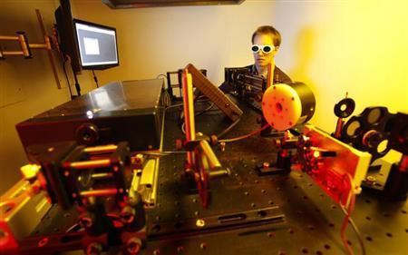 Dissertation student Jan Torgersen of Vienna University of Technology operates a newly developed 3D laser printer, in Vienna March 29, 2012. REUTERS/Herwig Prammer/Files