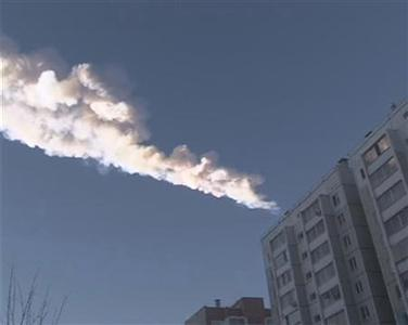The trail of a falling object is seen above a residential apartment block in the Urals city of Chelyabinsk, in this still image taken from video shot on February 15, 2013. REUTERS-OOO Spetszakaz