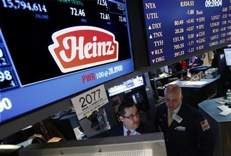 Traders work at the post that trades H.J. Heinz Co. on the floor of the New York Stock Exchange, February 14, 2013. Warren Buffett's Berkshire Hathaway and private equity firm 3G Capital will buy ketchup and baby food maker H.J. Heinz Co for $23.2 billion in cash, a deal that combines 3G's ambitions in the food industry with Buffett's hunt for growth. REUTERS/Brendan McDermid (UNITED STATES - Tags: BUSINESS FOOD)