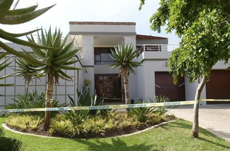 Police crime scene tape marks off the Pretoria home of South African ''Blade Runner'' Oscar Pistorius, February 14, 2013. REUTERS/Andrea Ettwein