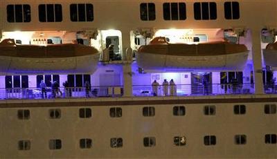 Weary passengers disembark crippled Carnival ship in...