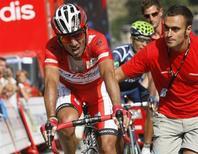 """El Katusha del español Joaquim """"Purito"""" Rodríguez podrá competir este año en la élite del ciclismo, el World Tour, después de que el equipo ruso tuviera éxito en su apelación ante el Tribunal de Arbitraje Deportivo (TAS, por sus siglas en francés) que revocó el rechazo a su solicitud original. En la imagen de archivo, el """"Purito"""" Rodríguez durante una etapa de la Vuelta a España con final en Fuente De, el 5 de septiembre de 2012. REUTERS/Joseba Etxaburu"""