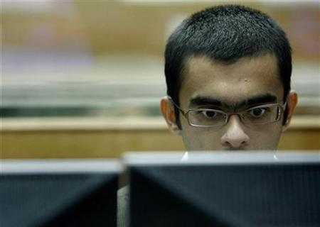 A broker looks at his terminal while trading at a stock brokerage firm in Mumbai July 29, 2008. REUTERS/Punit Paranjpe/Files