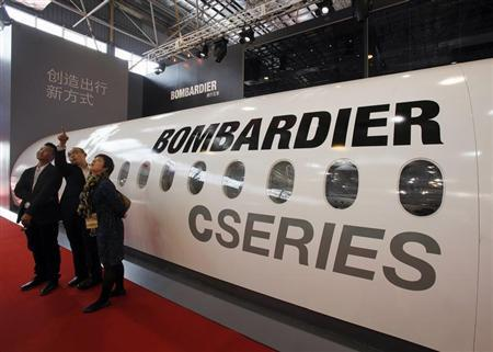 Visitors chat in front of a mock cabin of a Bombardier business jet on the first day of the China International Aviation & Aerospace Exhibition in the southern Chinese city of Zhuhai November 13, 2012. REUTERS/Bobby Yip