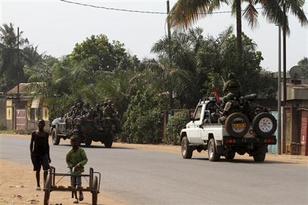 South African and Central African soldiers patrol a street in Bangui January 8, 2013. REUTERS/Luc Gnago