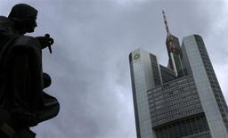 Dark clouds are seen over the head quarters of Germany's Commerzbank in Frankfurt, February 5, 2013. Commerzbank will publish its annual figures during a news conference next week. REUTERS/Kai Pfaffenbach (GERMANY - Tags: BUSINESS) - RTR3DDFZ