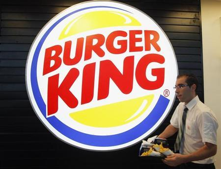 An employee prepares a food order on the opening day of the Burger King restaurant at the Marignane airport hall December 22, 2012. REUTERS/Jean-Paul Pelissier