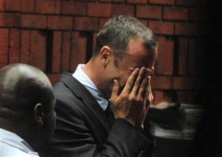 South African 'Blade Runner' Oscar Pistorius breaks down during his court appearance in Pretoria February 15, 2013. Pistorius, a double amputee who became one of the biggest names in world athletics, broke down in tears on Friday after he was charged in court with shooting dead his girlfriend, 30-year-old model Reeva Steenkamp, in his Pretoria house. REUTERS/Antonie de Ras