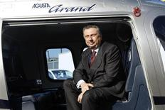 Finmeccanica Chairman and Chief Executive Officer Giuseppe Orsi poses in a helicopter during the opening ceremony of the new Terminal of Vertiporto dell'Urbe in Rome January 19, 2009. REUTERS/Remo Casilli