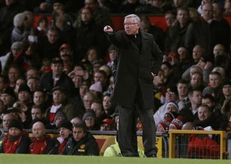Manchester United's manager Alex Ferguson gestures during the English Premier League soccer match against Everton at Old Trafford in Manchester, northern England February 10, 2013. REUTERS/Phil Noble