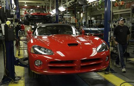 A Chrysler auto assembly worker walks past a 2008 Dodge Viper on the assembly line of the Chrysler Conner Avenue Assembly plant Detroit, Michigan March 12, 2008. REUTERS/Rebecca Cook