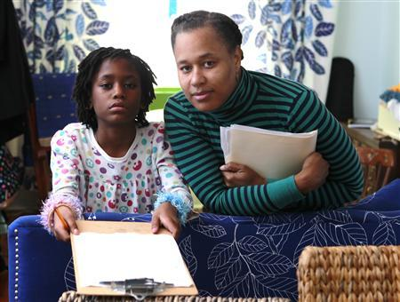 Heather Davis-Jones (R) and her daughter Shakia at their residence in Philadelphia, Pennsylvania, February 9, 2013. REUTERS/Tim Shaffer