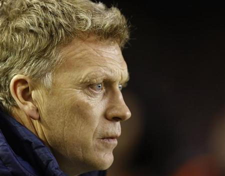 Everton's coach David Moyes watches ahead of their English Premier League soccer match against West Bromwich Albion at Goodison Park in Liverpool, northern England January 30, 2013. REUTERS/Phil Noble