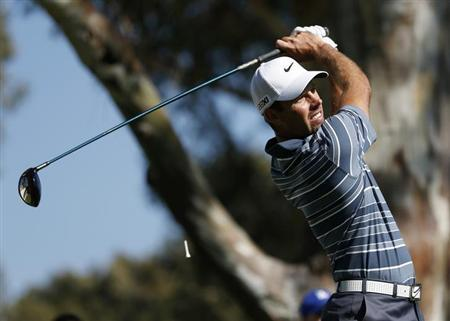 Charl Schwartzel of South Africa tees off on the 15th hole during the first round of the Northern Trust Open golf tournament at Riviera Country Club in Los Angeles February 14, 2013. REUTERS/Danny Moloshok