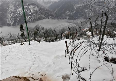 Barbed wire fencing constructed by the Indian army near the Line of Control (LoC) is pictured in Churunda village, about 129 km (80 miles) northwest of Srinagar, January 12, 2013. REUTERS/Danish Ismail