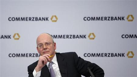 Commerzbank Chief Executive Martin Blessing listens during the bank's annual news conference in Frankfurt February 15, 2013. Blessing told investors that the board of directors at Germany's second-largest lender backs his multi-year restructuring plan. REUTERS/Lisi Niesner (GERMANY - Tags: BUSINESS) - RTR3DTO6