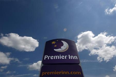 The sign of Whitbread's Premier Inn hotel is seen in Ashby de la Zouch, central England June 17, 2008. REUTERS/Darren Staples