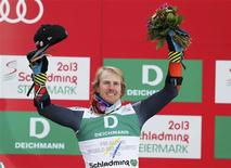 First placed Ted Ligety of the U.S. celebrates on the podium during the flower ceremony after the men's Giant Slalom race at the World Alpine Skiing Championships in Schladming February 15, 2013. REUTERS/Leonhard Foeger